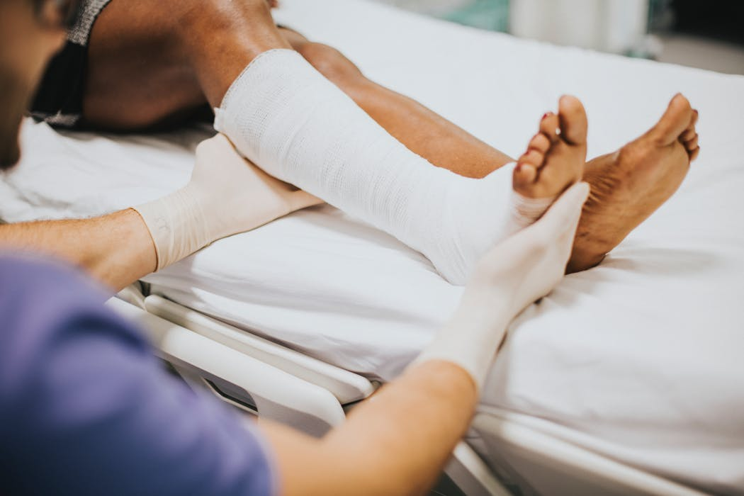 doctor checking a patient's leg