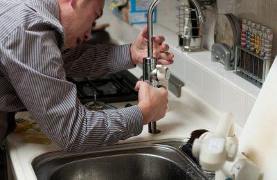 Plumber Repairing A Leak