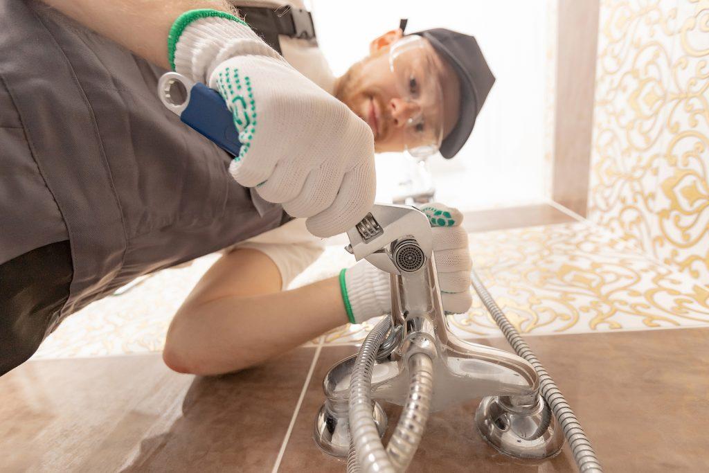 trusted plumber in Wellington installing shower stall