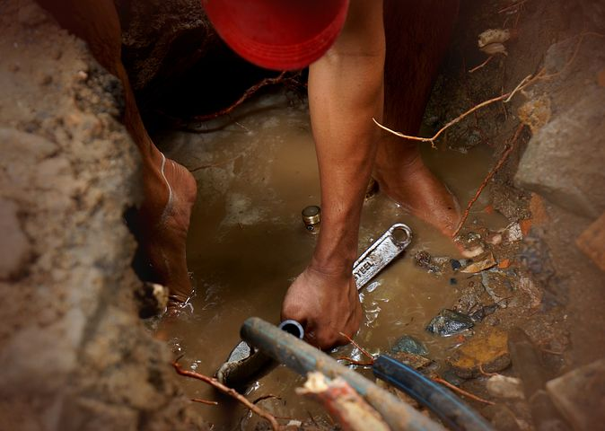 Plumber fixing leaks