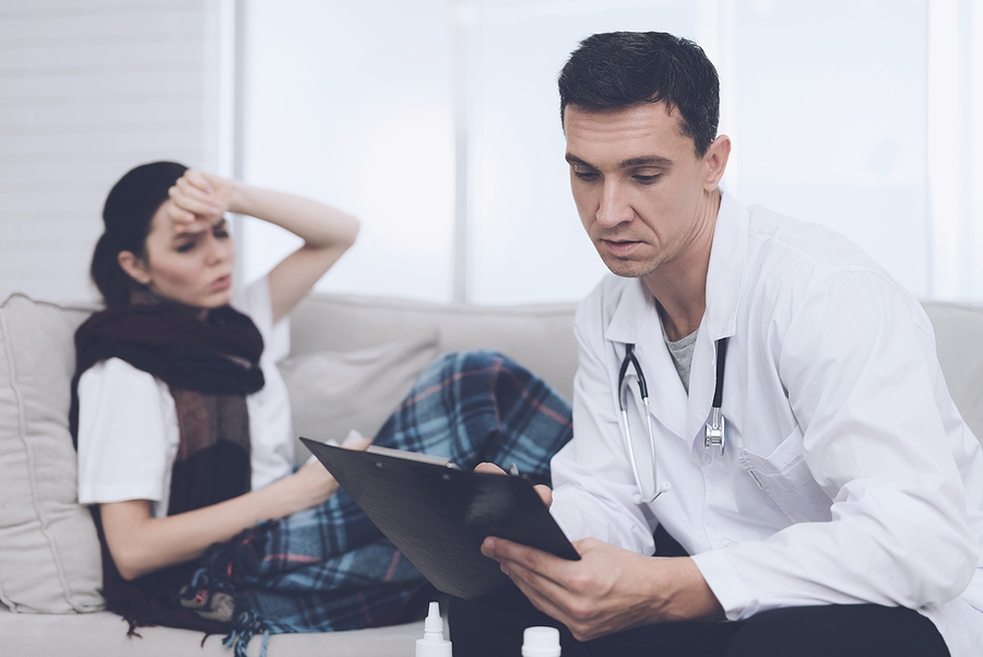 Brisbane home doctor checking a sick patient
